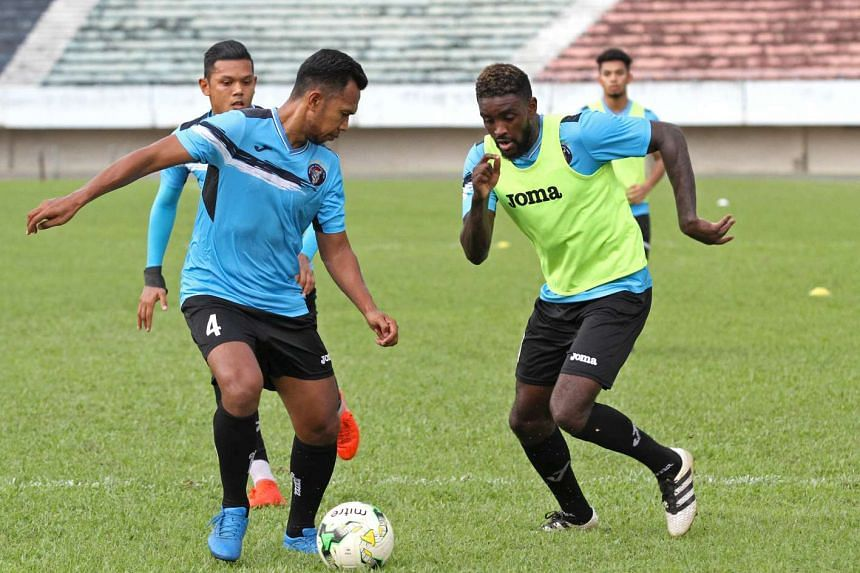 New Warriors FC striker Joel Tshibamba (front, right) during a training session at Jurong Stadium on April 6, 2017.
