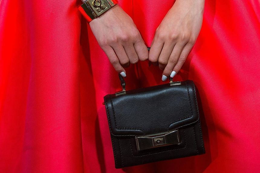 A Kate Spade handbag. Coach says the complementary nature of the businesses should bring US$50 million in cost savings in three years after the deal closes. The idea is to improve scale and inventory management, as well as streamline Kate Spade's sup