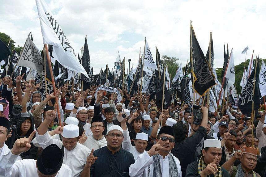 An HTI supporter during a past rally. The Indonesian government yesterday said it aims to take legal measures to dissolve the radical Islamist group. Protesters from the Hizb ut-Tahrir Indonesia (HTI) rallying in support of Muslim clerics at the Nati