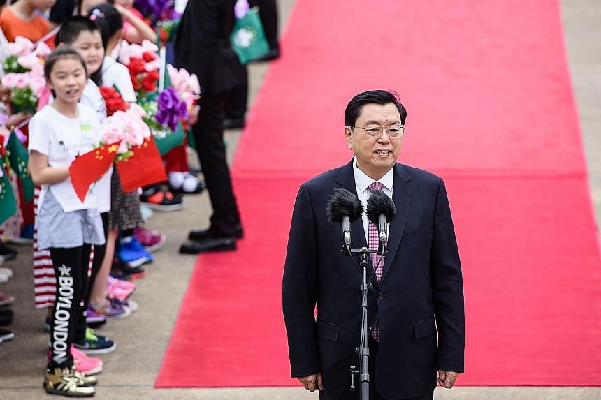 Mr Zhang Dejiang, the head of China's Parliament, received a red-carpet welcome at Macau's airport yesterday. He said the special administrative region of China has made brilliant achievements but faces an important stage as it makes a transition in