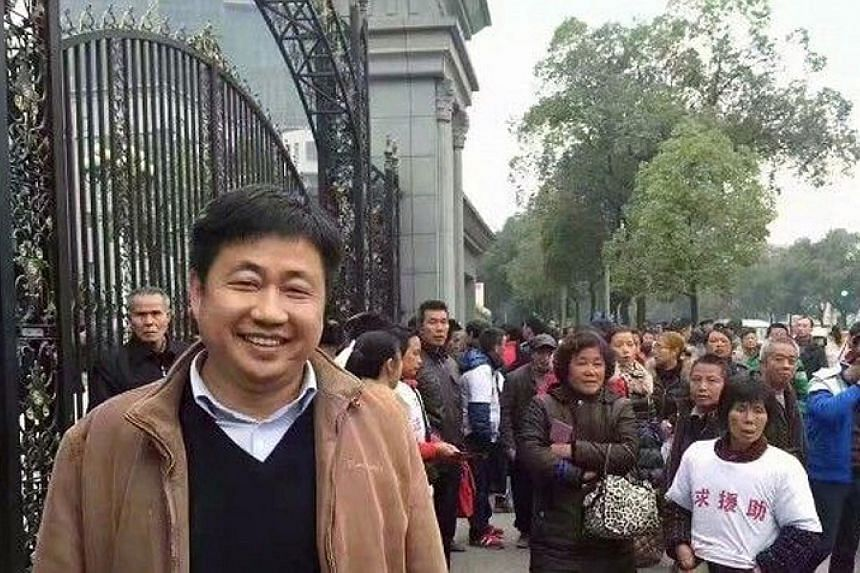 "Chinese human rights lawyer Xie Yang in an undated photo. He has been charged with ""inciting subversion of state power and disrupting court order""."