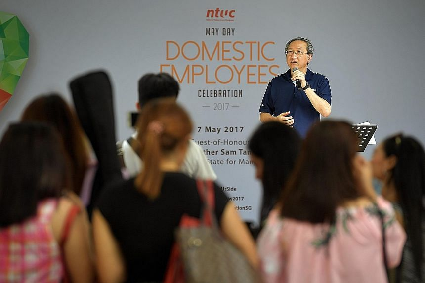Minister of State for Manpower Sam Tan at NTUC's May Day Domestic Employees Celebration on Sunday. Yesterday, in Parliament, he said that employers should ensure their maids are properly trained and comfortable with performing a task before entrustin