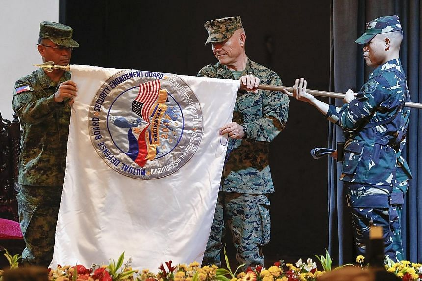 Philippine Lieutenant- General Oscar Lactao (left) and US Marines Lieutenant- General Lawrence Nicholson at the opening ceremony of the annual Balikatan exercise in Quezon City, east of Manila, yesterday.