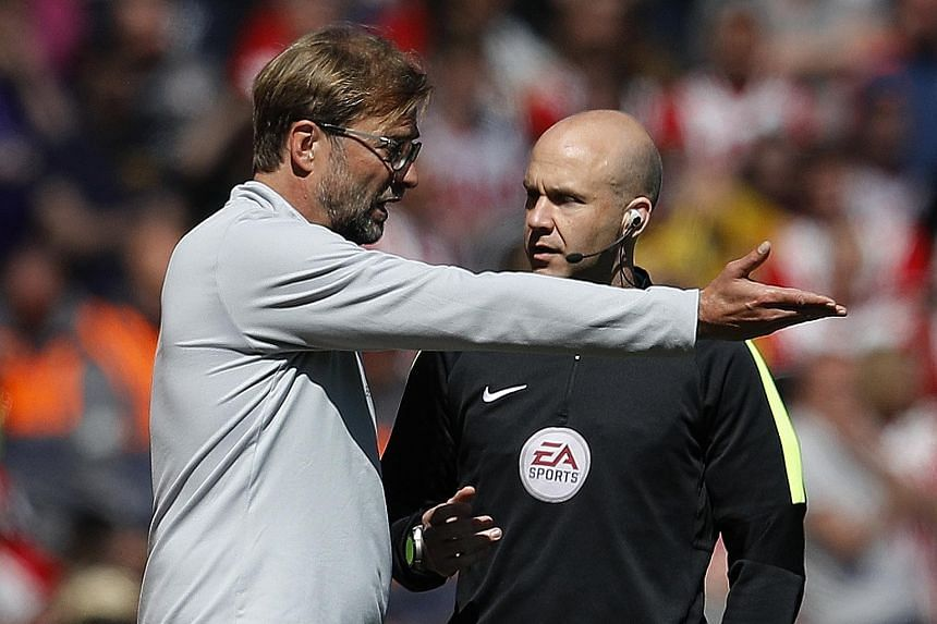 Liverpool manager Jurgen Klopp speaking to fourth official Anthony Taylor during the Premier League match against Southampton at Anfield which ended 0-0.