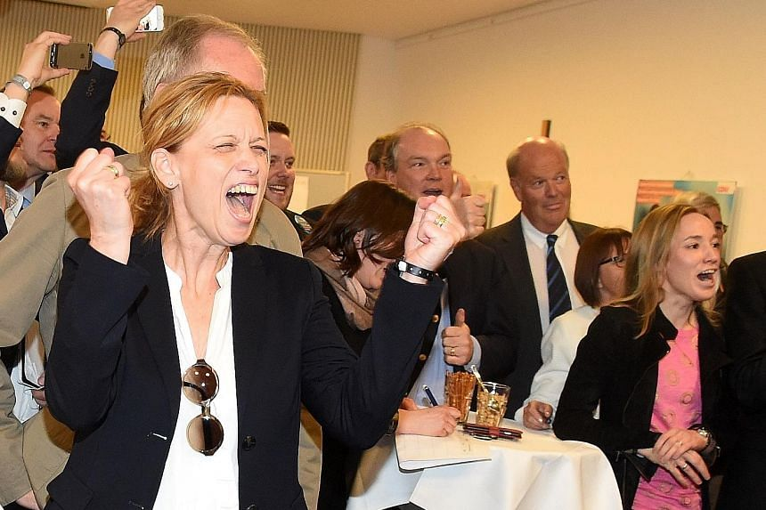 Members of the Christian Democratic Union celebrating their victory in Schleswig- Holstein state election in Kiel, northern Germany, on Sunday.