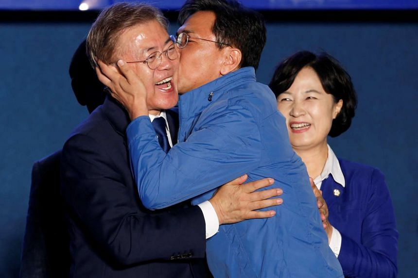 South Chungcheong governor An Hee Jung kissing South Korea's president-elect Moon Jae In at Gwanghwamun Square in Seoul on May 9, 2017.