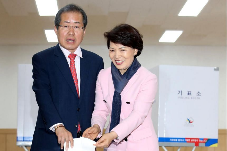 Hong Joon Pyo (left), presidential candidate of the conservative Liberty Korea Party, and his wife Lee Soon Sam cast their ballots at a polling station in eastern Seoul.