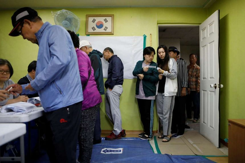 People cast their votes at a polling station during the presidential elections in Seoul, South Korea, on May 9, 2017.