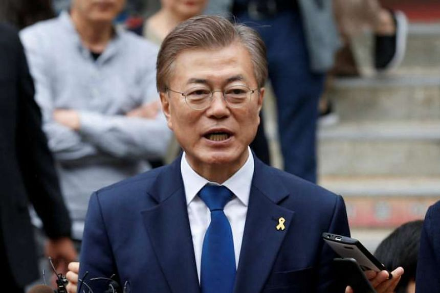Moon Jae In speaks to the media after voting at a polling station in Seoul, South Korea, on May 9, 2017.