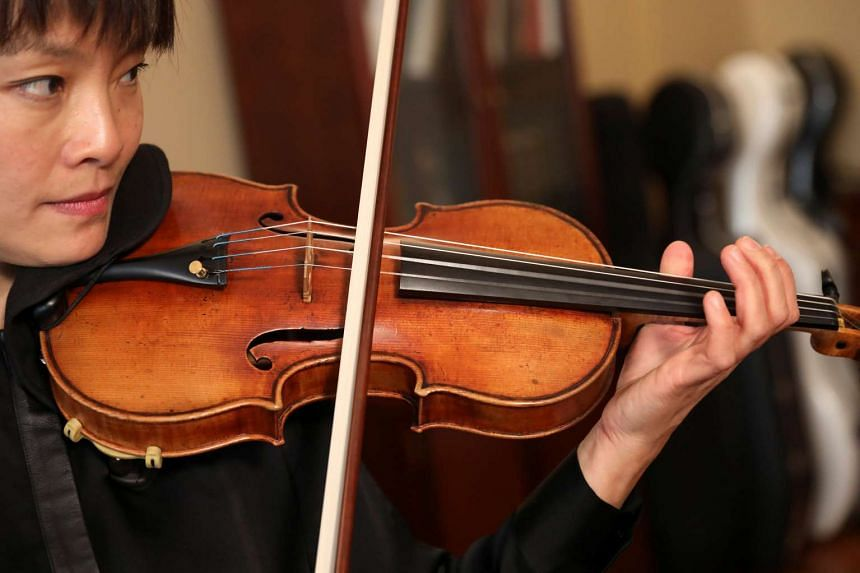Violinist Mira Wang plays the Ames Stradivarius violin, that was stolen in 1980, and is valued at more than $7 million.
