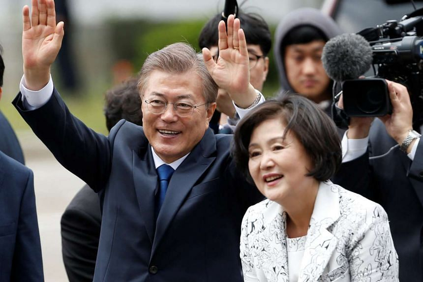 South Korea President Moon Jae In and his wife Kim Jung Sook arriving at the presidential Blue House in Seoul, on May 10, 2017.