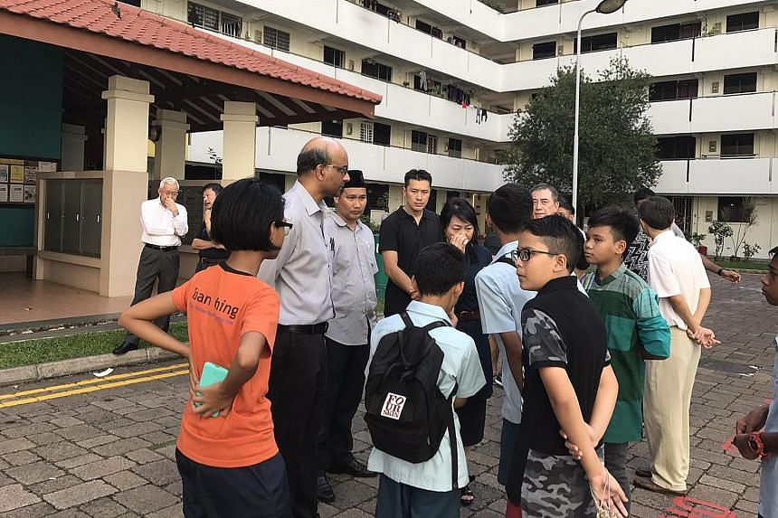 Deputy Prime Minister Tharman Shanmugaratnam at the wake held in Ho Ching Road for 12-year-old Muhammad Suhaimi Sabastian, who drowned off East Coast Park on Monday.
