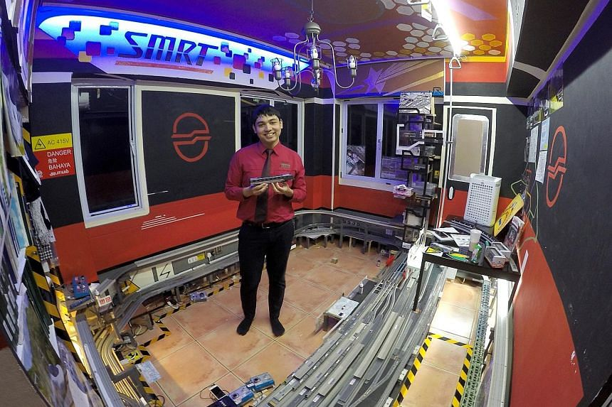 """Mr Isaac Nathaniel D'Souza, 19, has been mad about trains since the age of three. So it seems apt that he not only hand-painted and decorated his room to be a """"train city"""" - a labour of love taking two years - but that he also works in the sector he"""