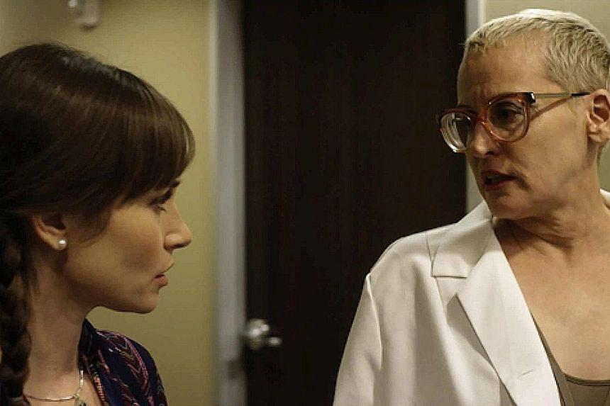 Jocelin Donahue (left) and Lori Petty star in Dead Awake.