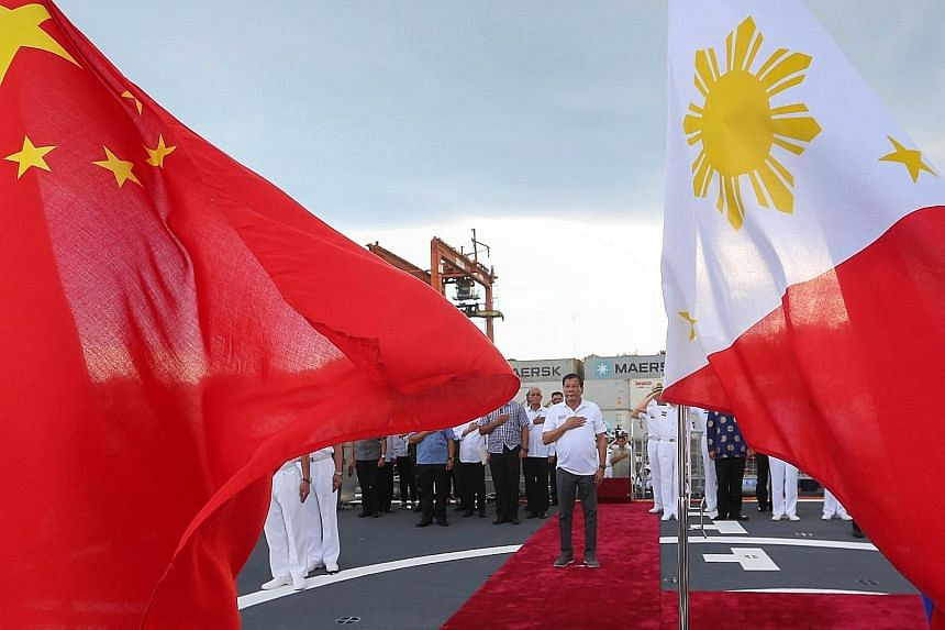 A handout photo made available by the Presidential Photographers Division shows Philippine President Rodrigo Duterte during a tour of a Chinese naval ship in Davao City, southern Philippines. He gave three Chinese warships the red-carpet treatment in