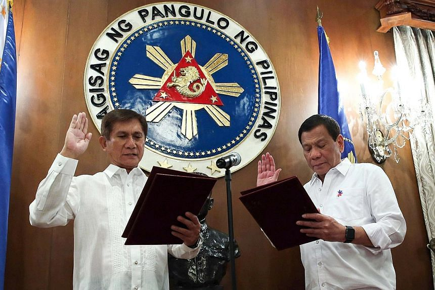 President Rodrigo Duterte swearing in the new Environment and Natural Resources Secretary Roy Cimatu on Monday. The Philippine leader will be pitching an ambitious $243 billion infrastructure programme for the country.