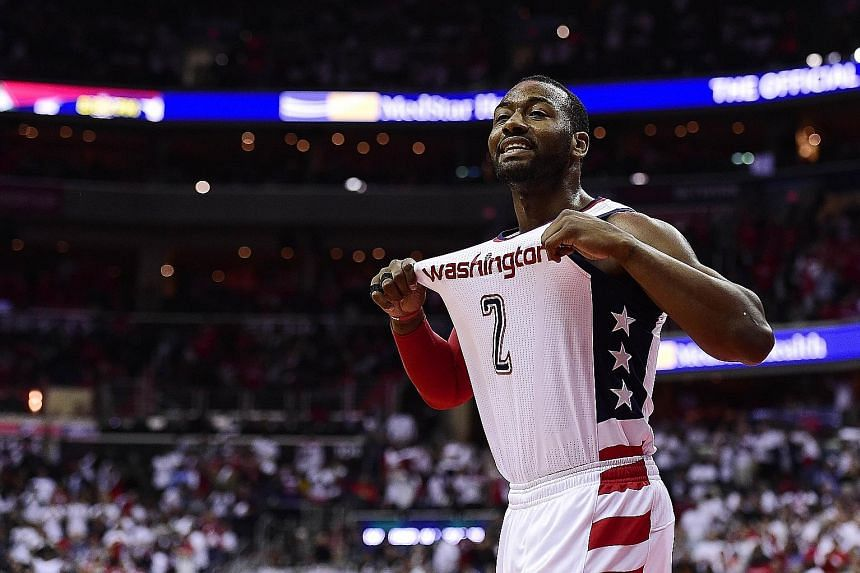 Washington Wizards' John Wall celebrating during the third quarter in Game Four of the Eastern Conference semi-finals against the Boston Celtics.