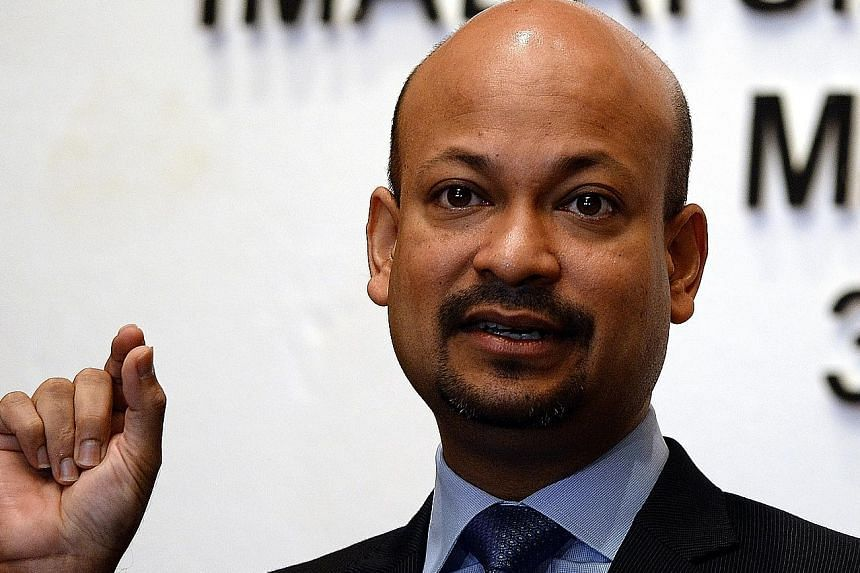 Malaysia's Second Finance Minister Johari Abdul Ghani (top) and 1MDB president Arul Kanda Kandasamy were part of a committee set up to manage the restructuring and divestment of 1MDB's assets.