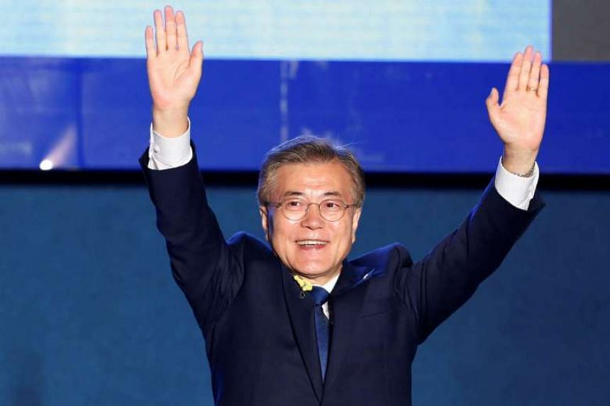 South Korea's president-elect Moon Jae In celebrating at Gwanghwamun Square in Seoul on May 9, 2017.