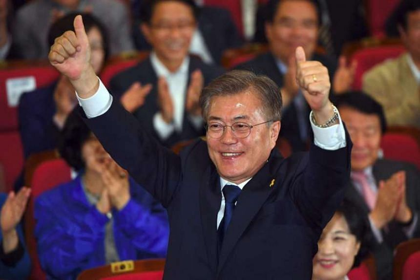 South Korean presidential candidate Moon Jae In reacting as he watches the result of exit polls of the election, in Seoul on May 9, 2017.