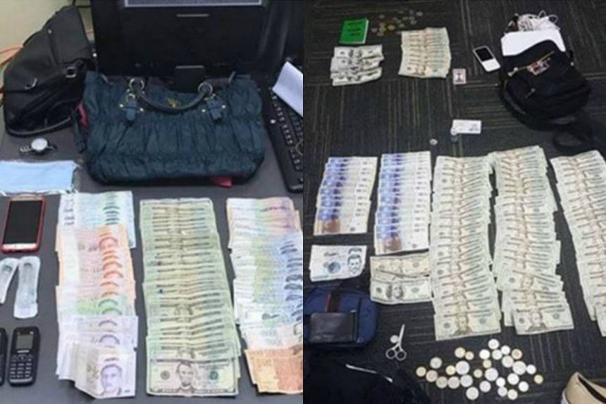 Cash and items seized from the suspects for investigation.