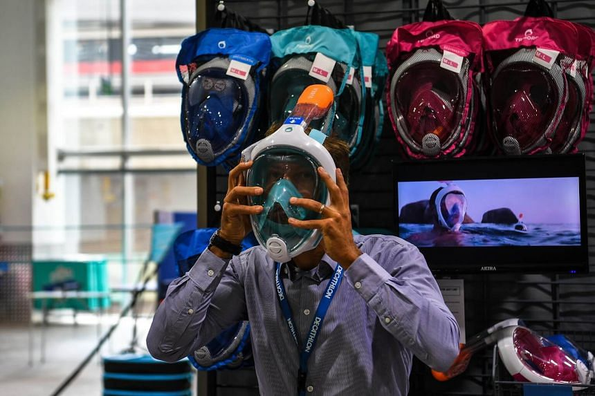 Decathlon Singapore Country Leader Bastien Grandgeorge puts on an easybreath mask at the Decathlon store during a media preview on May 11, 2017.