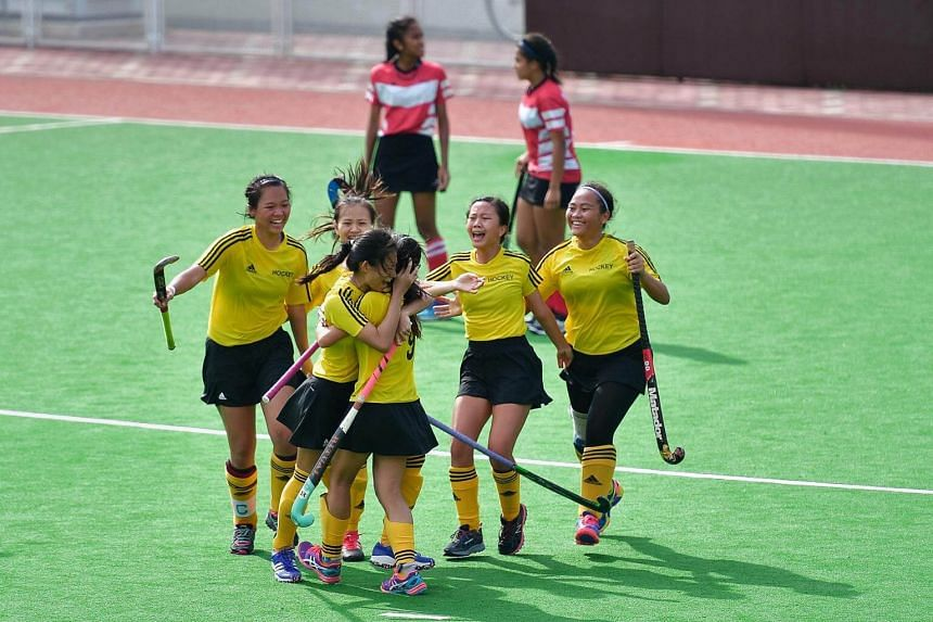 The Victoria Junior College team celebrates after winning 1-0 during the A' Division girls Hockey Finals on May 11, 2017.