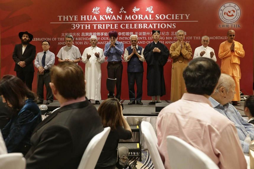 The Inter-Religious Organisation leading a minute of silent prayer during Thye Hua Kwan Moral Society's 39th Triple Celebrations dinner event at Hilton Hotel on May 11, 2017.