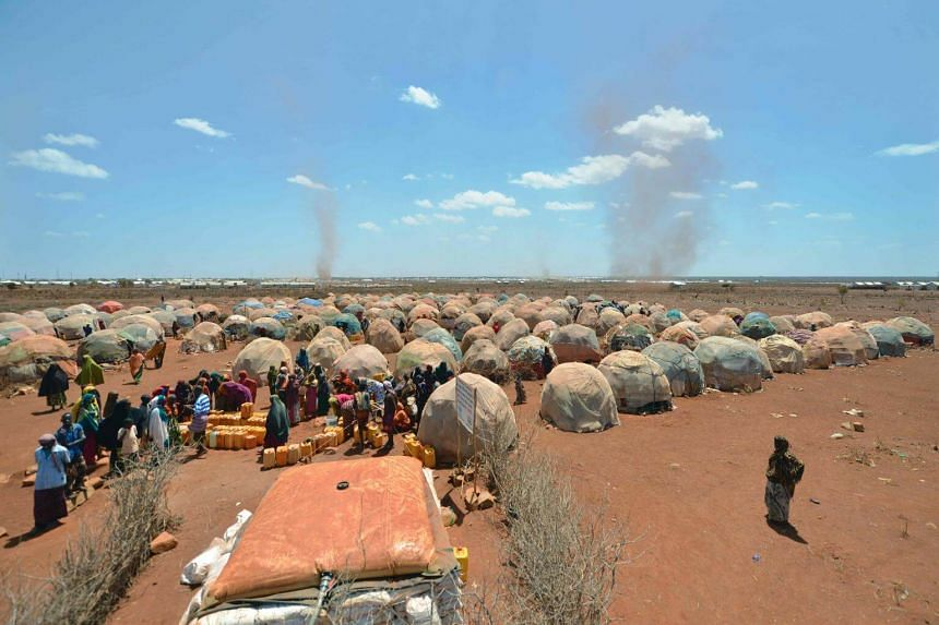 Displaced Somalian families queueing for water at a UN collection point. Somalia is facing a severe drought that has left the country on the brink of a famine.