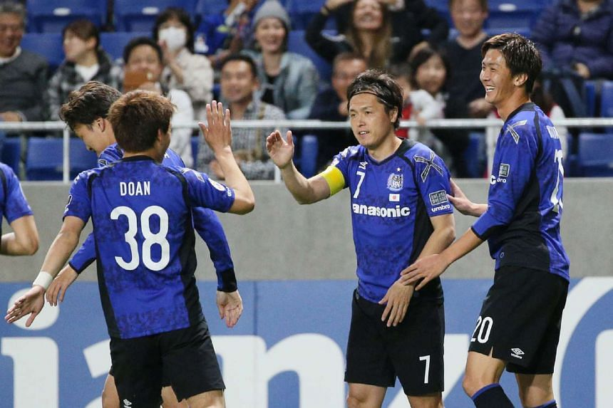 Japan's Gamba Osaka players during the AFC Champions League football match at Suita Stadium in Osaka prefecture on April 25, 2017.