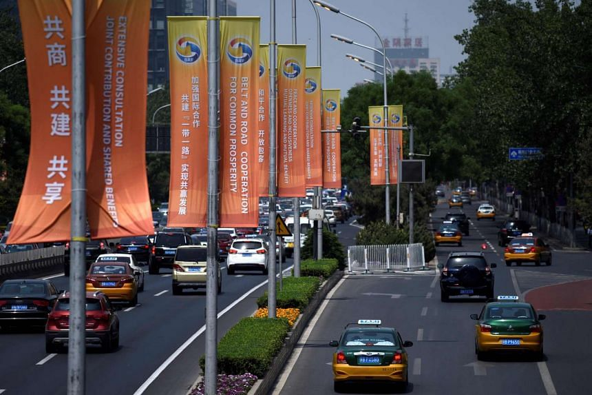 Banners displayed along a street in Beijing ahead of the Belt and Road forum, in which seven top Asean leaders will attend.