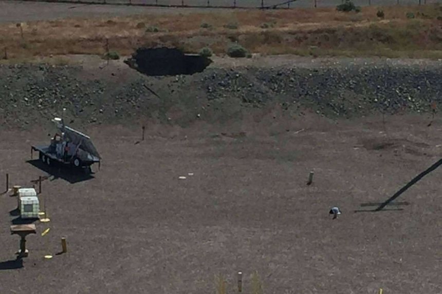 The hole over a decommissioned plutonium-handling rail tunnel is shown at the Hanford nuclear site.