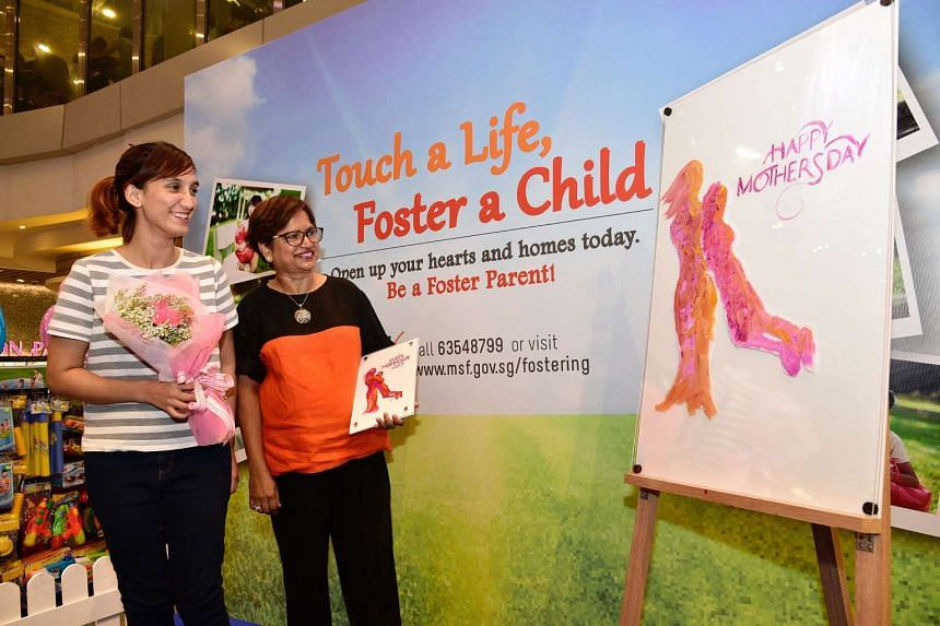 Mrs Bannumathi Hodge, 60, and her daughter at the MSF Fostering Service Roadshow.