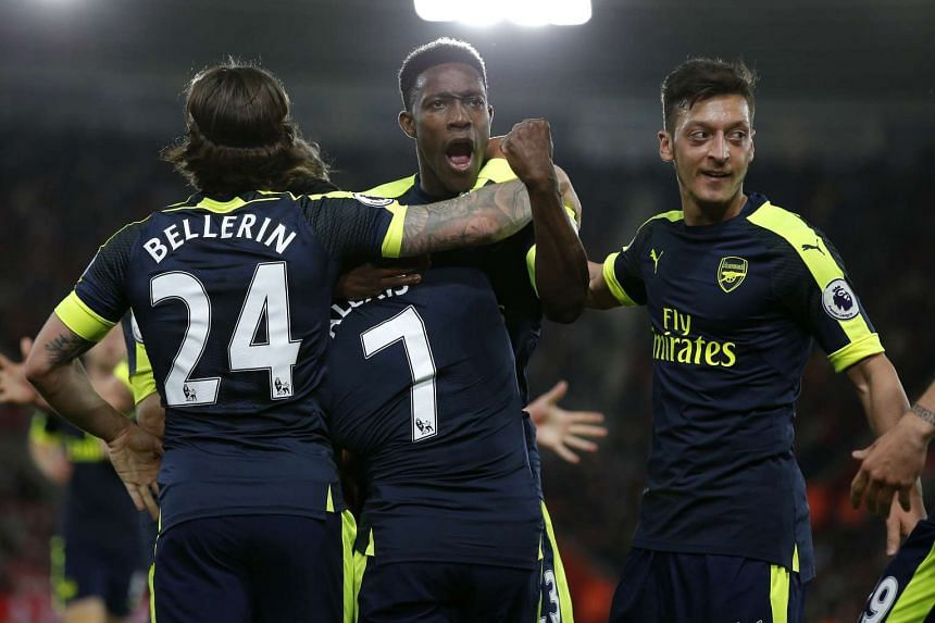 Arsenal's Alexis Sanchez celebrates scoring their first goal with Danny Welbeck and team mates.