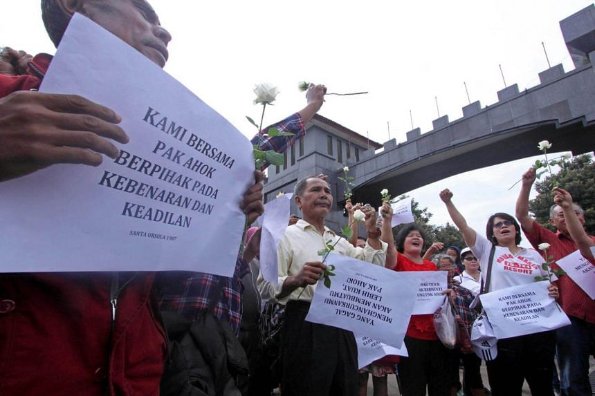 Supporters of former Jakarta governor Ahok holding a rally outside the Brimob detention centre in West Java, Indonesia where he is being held. Ahok has called upon them to leave the area.
