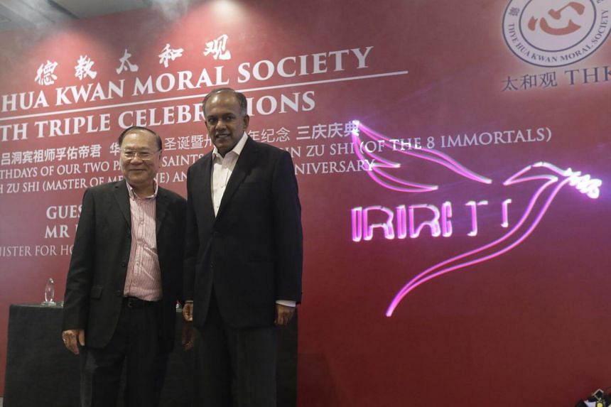 Thye Hua Kwan Moral Society chairman Lee Kim Siang and Home Affairs and Law Minister K Shanmugam standing next to the new dove logo after its launch at Hilton Hotel on May 11, 2017.