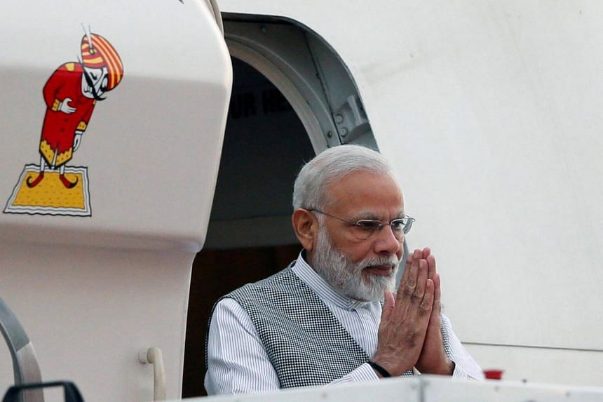 Prime Minister Narendra Modi gestures as he arrives for the United Nations Vesak Day celebrations in Katunayake, Sri Lanka on May 11, 2017.