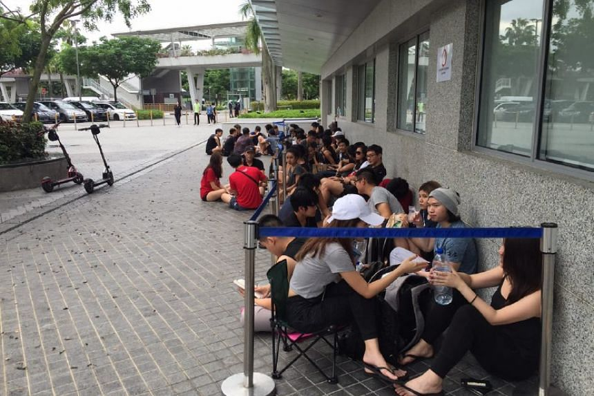 Fans of Ed Sheeran queue to buy tickets for his November concert this year.