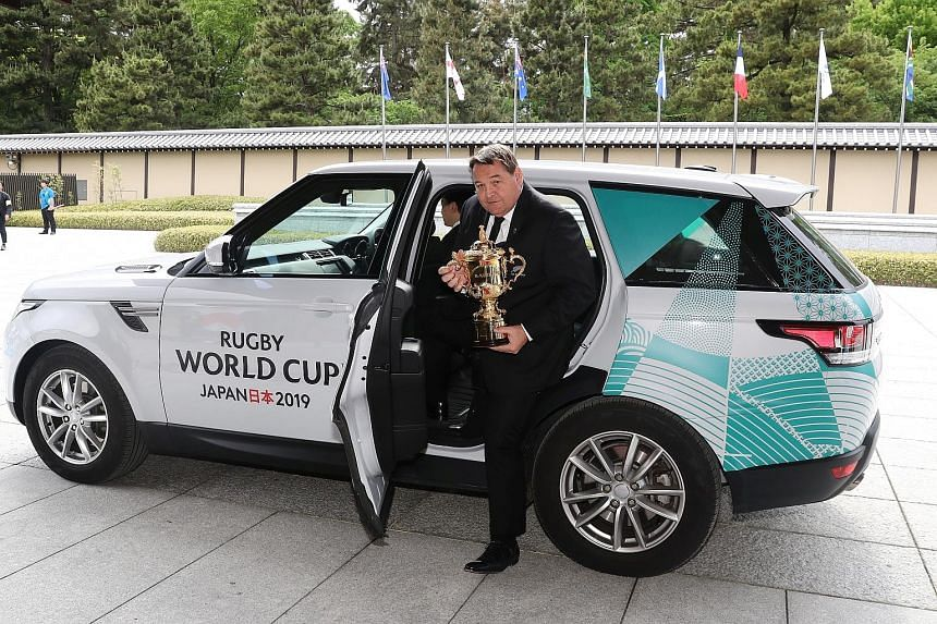 New Zealand head coach Steve Hansen arriving with the Webb Ellis Cup at the Kyoto State Guest House before yesterday's tournament draw for the 2019 Rugby World Cup, which will be hosted by Japan.