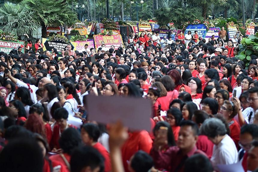 Supporters of Basuki Tjahaja Purnama, also known as Ahok - who is non-Muslim and an ethnic Chinese - gathering at City Hall in Jakarta yesterday. His guilty verdict and sentence of two years' jail over a speech he gave last September have thrust Indo