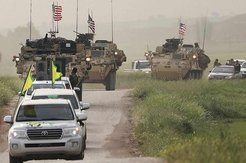 Kurdish forces in Syria heading a convoy of US military vehicles. The US sees the militia as a valuable partner in the fight against ISIS.