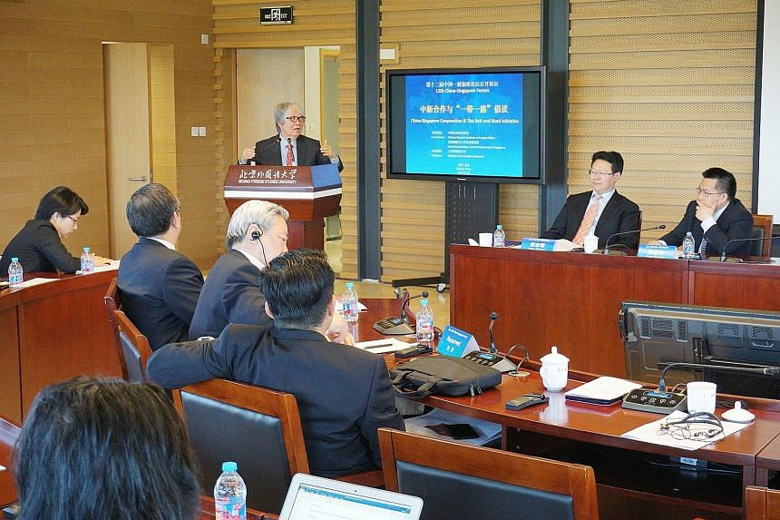 Professor Tommy Koh speaking at the forum yesterday, joined by (from right) China Institute of International Studies vice-president Ruan Zongze and Chongqing Connectivity Initiative deputy director Peng Zhiming.