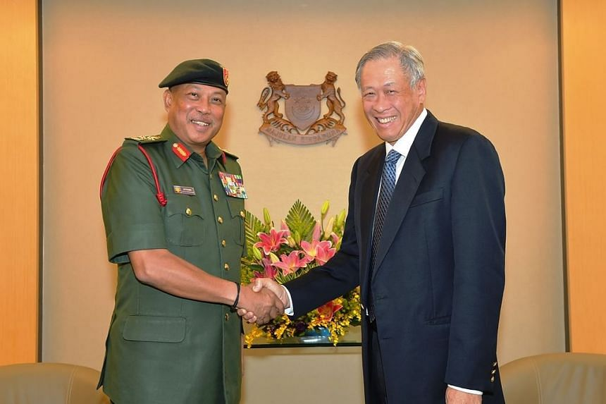 General Affandi shaking hands with Singapore Defence Minister Ng Eng Hen during the former's introductory visit to Singapore, on May 11, 2017.