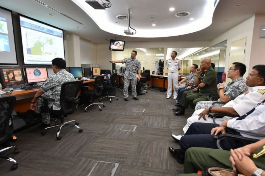 General Affandi (third from right) being show the Information Fusion Centre (IFC)'s role in enhancing regional maritime information-sharing, on May 11, 2017.