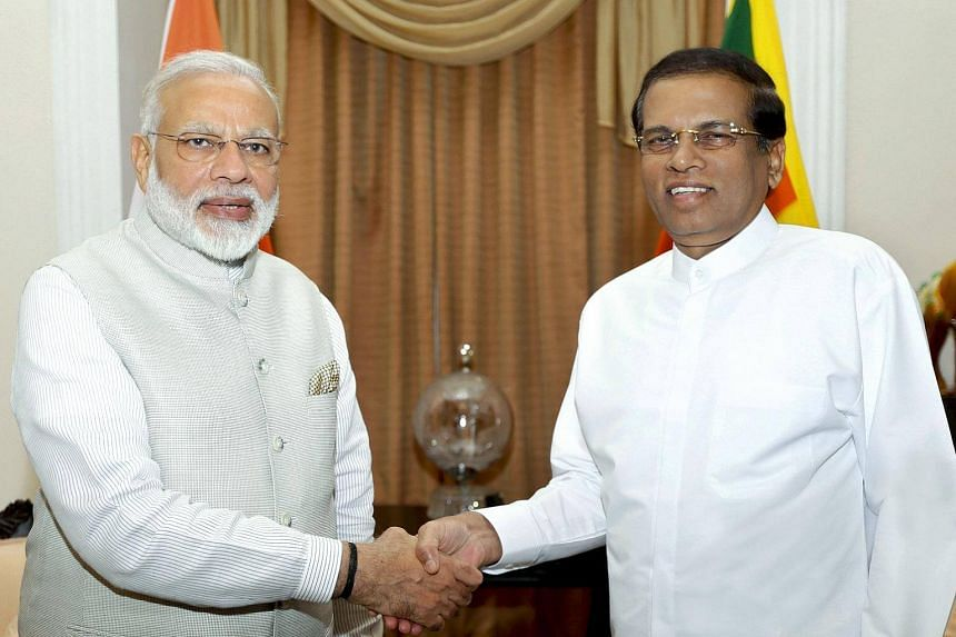Indian Prime Minister Narendra Modi (left) and Sri Lankan President Maithripala Sirisena (right) are meeting in Colombo in an effort to boost the relationship between both countries.