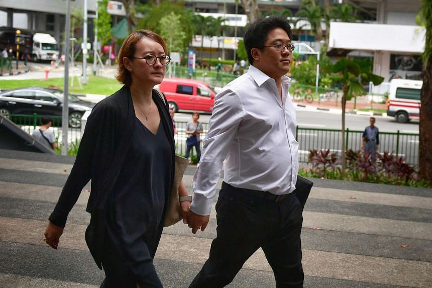 Ong Jenn (right) and his wife arriving at the State Courts on Feb 20, 2017.