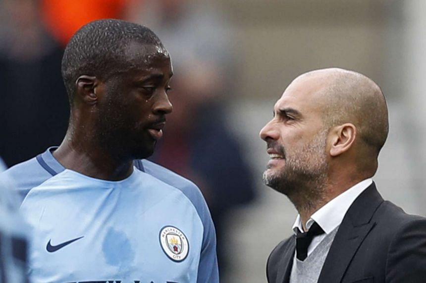 Manchester City's Yaya Toure with manager Pep Guardiola in March 2017.