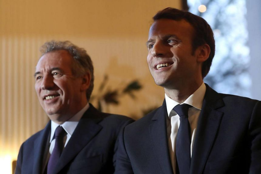 Emmanuel Macron (right) and Francois Bayrou posing in front of journalists as part of their meeting at the Palais de Tokyo in Paris.