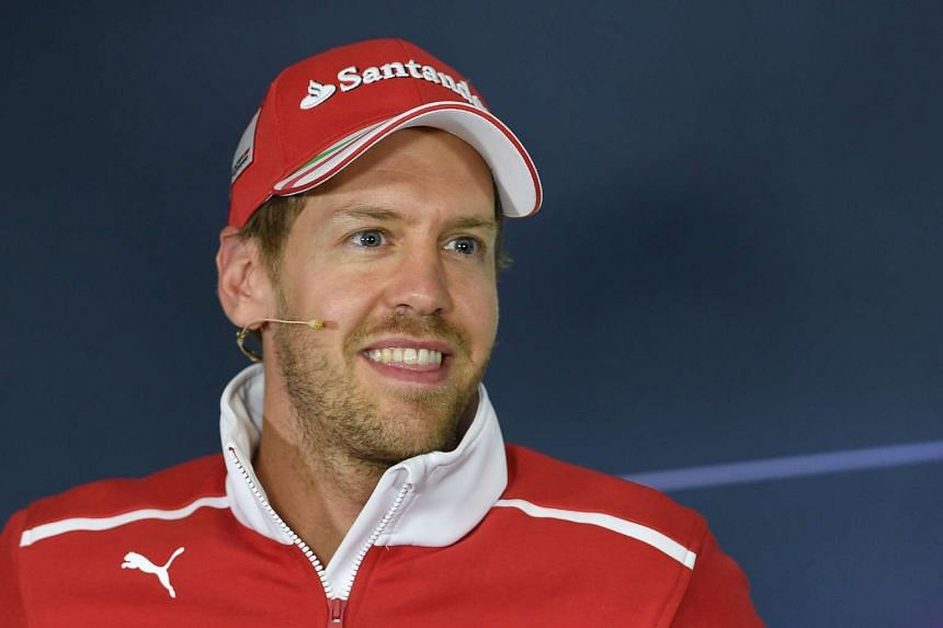 Vettel attends a press conference ahead of the Spanish grand prix.
