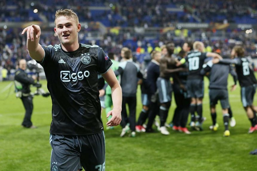 Ajax's Matthijs de Ligt celebrates after the match.
